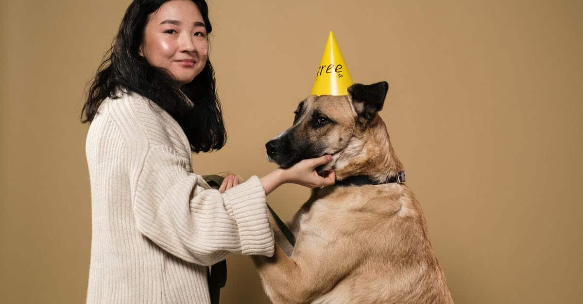 A person holding a dog